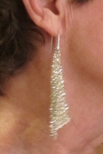 Woman wearing Swarovsky Fit Silver Shade earrings. Photo by BF Newhall