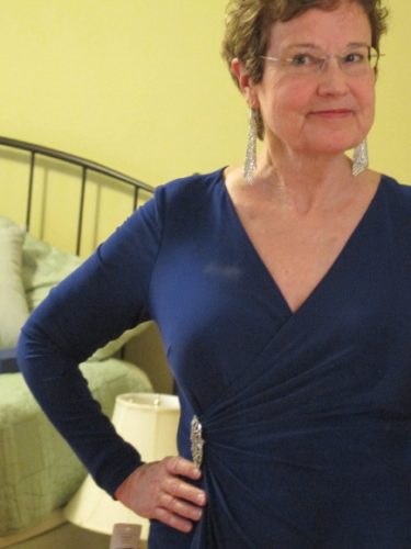 Barbara Falconer Newhall in purple knit gown wearing Swarovsky fit silver shade earrings. Photo by BF Newhall