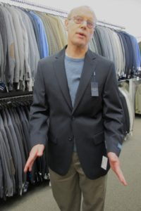 Father of the groom trying on coat for the wedding at Men's Wearhouse Emeryville, CA. Photo by BF Newhall
