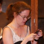 Author Lauren Winnerchecks her cell phone at The Glen in Santa Fe in 2009. Photo by BF Newhall