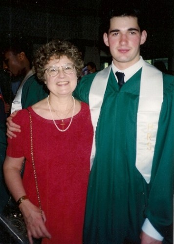 Peter Newhall in green high school graduation gown with his mother Barbara Falconer Newhall. Photo by BF Newhall