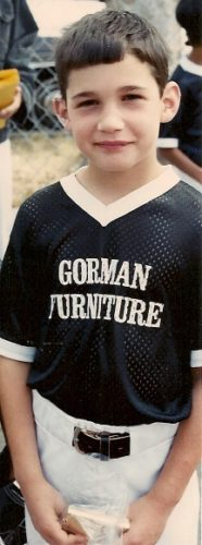 eight-year-old boy in Gorman Furniture Berkeley baseball league uniform. Photo by BF Newhall