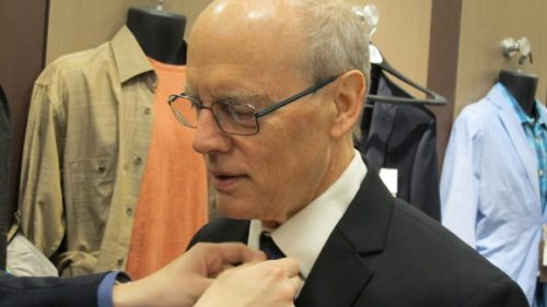 Father of the groom Jon Newhall tried on his wedding tux at Men's Wearhouse in Eden Prairie, MN. Photo by BF Newhall