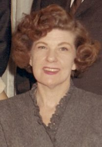 portrait of a red headed woman, circa 1960. Ludington Studios photo.