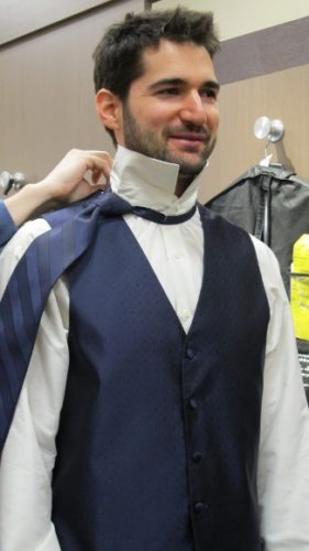 Groom tries on fashionable purple tie and vest at Men's Wearhouse, Eden Prairie, MN. photo by BF Newhall
