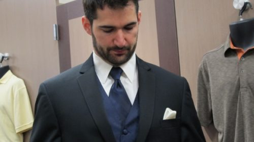 Bearded groom wearing purple necktie and vest with tux at Mens Wearhouse. Photo by BF Newhall