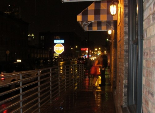 A young couple outside The Bachelor Farmer restaurant, Minneapolis, MN on a rainy night. Photo by BF Newhall