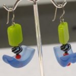 A pair of whimsical earrings by Susan Brooks of Berkeley with blue and green beads. Photo by BF Newhall