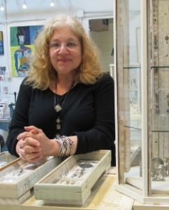 Jewelry artist Susan Brooks with jewelry cases in her Berkeley ca studio. PHoto by BF Newhall