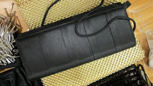 A long, narrow black satin evening bag at Macy's. Photo by BF Newhall