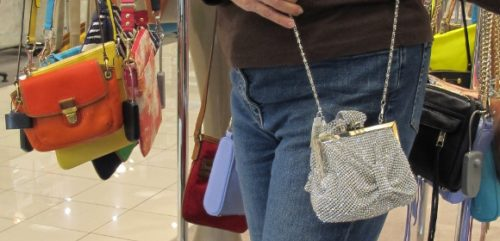 A small silver evening bag at Nordstrom with ruching and a chain sells for $268. Photo by BF Newhall