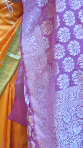 Part of an orange and green sari and a purple sari at an Indian wedding in the San Francisco Bay Area. Photo by BF Newhall