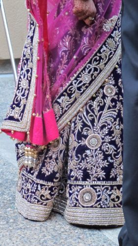 The bride wore a purple and cerise sari embroidered intricately with silver. Photo by BF Newhall