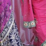 Bride in violet and cerise sari with guest in fuchsia sari at a wedding in San Francisco Bay Area. Photo by BF Newhall