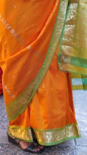 Orange silk sari with bright green border at an Indian wedding. Photo by BF Newhall