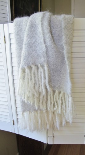 A white and cream wool shawl with long fringes handwoven by Mary Helen Blohm. Photo by BF Newhall
