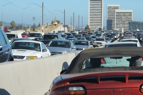 ten lanes of bumper to bumper freeway traffic in los angeles. photo by bf newhall