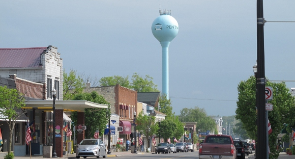 Hancock Street in downtown Pentwater, MI, village with water tower, shops and cars. Photo by BF Newhll