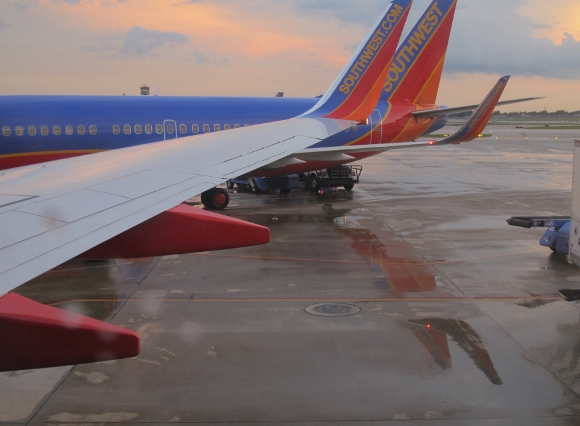 a southwest airline plane on a rainy tarmack. Photo by BF Newhall