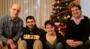 a family of four poses for a christmas photo in front of the tree. Photo by BF Newhall