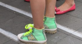Bright blue-green high top sneakers on a bare-legged Shanghai girl. Photo by BF Newhall