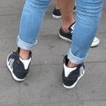 A Shanghai girls wears navy and white western-style sneakers with tight-fitting, cuffed jeans. Photo by BF Newhall