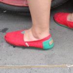 woman wearing red espadrilles with turquoise trim on a shanghai street. Photo by BF Newhall