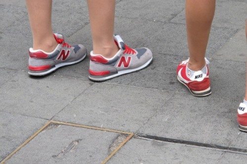 bare legged women in shanghai wear new balance and nike sneakers. Photo by bf newhall