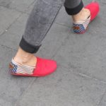 A Shanghai woman wears tight grey slacks showing ankles and red, white and blue espadrilles. PHoto by BF Newhall