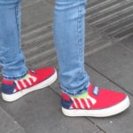A Shanghai girl wears jeans and slip on sneakers with stars and stripes of the American flag. Photo by BF Newhall