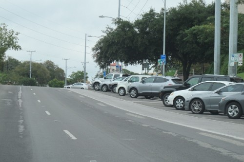 Cars parked on an angle facing out toward the street in Austin TX. Photo by BF Newhall