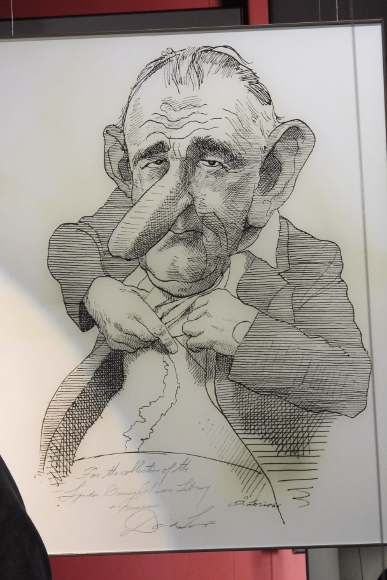 Cartoon of LBJ showing off his scar in the Johnson Presidential LIbrary in Austin, TX. Photo by BF Newhall