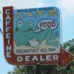 "A sign for the Bouldin Creek Cafe in East Austin, TX, reads, ""Caffeine Dealer."" Photo by BF Newhall"