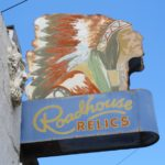 Roadhouse Antiques sign with an Indian chief with feathered bonnet, Austin, TX. Photo by BF Newhall
