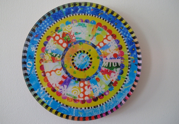 A round, mandala style work of art made from colorful plastic shopping bags by virginia fleck of austin tx. photo by bf newhall