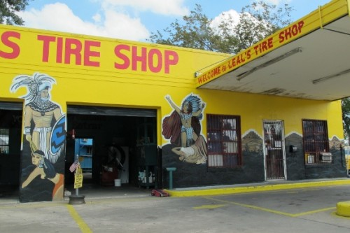 Leal's Tire Shop in Austin TX features yellow walls and murals of Montezuma. photo by bf newhall
