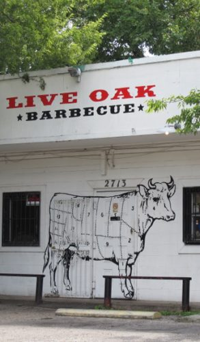 The facade of the Live Oak Barbecue restaurant in Austin TX features a diagram of a cow sectioned off for butchering. Photo by BF Newhall