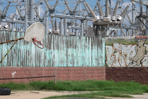 A power plant on Lady Bird Lake in Austin TX scheduled to be removed, with graffitti and a basketball net. Photo by BF Newhall
