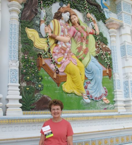 Writer Barbara Falconer Newhall visits the Radha Madhav Dham temple in Austin, TX, and a portrait of Krishna and his consort. Photo by Don Lattin
