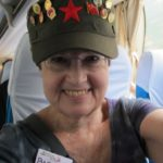 Writer Barbara Falconer Newhall wears a khaki Mao hat with numerous Mao buttons in Beijing. Photo by BF Newhall