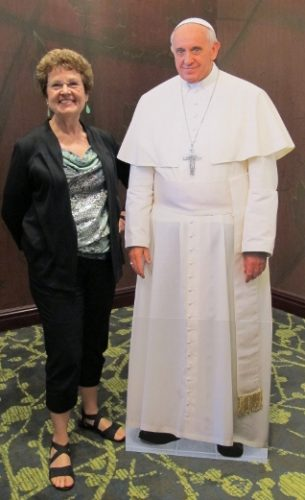 Writer Barbara Falconer Newhall poses with a mock-up of Pope Francis at the Religion Newswriters Association conference in Austtin, 2013. RNA photo