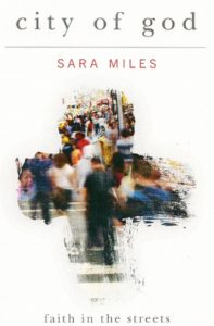 city of god book cover, by sara miles , shows a smudged cross with view of sidewalk with pedestrians.