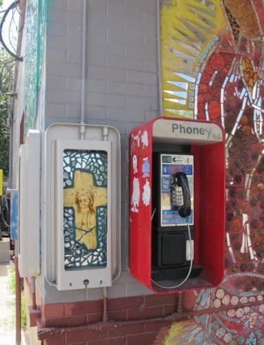 A mural dipicting Jesus on the cross is painted on an fuse box next to a telephone at a convenience store in east Austin, TX. Photo by BF Newhall