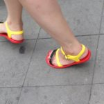 red-soled plastic sandals with black and yellow straps on the streets of Shanghai. photo by BF Newhall