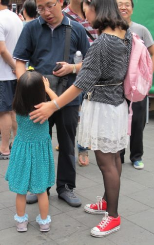 In Shanghai a mother and father look at their daughter in what could be a one-child family. Photo by BF Newhall