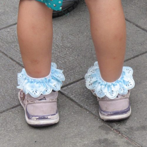 A Chinese toddler's pink sneakers and powder blue ruffled socks in Shanghai. Photo by BF Newhall