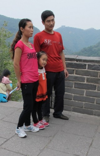 An Asian family that seems to be one-child gets its picture taken on the Great Wall of China. Photo by BF Newhall