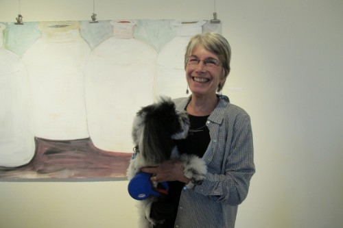 Berkeley CA ceramist Nancy Selvin with her dog in front of her large painting, 2013. Photo by BF Newhall
