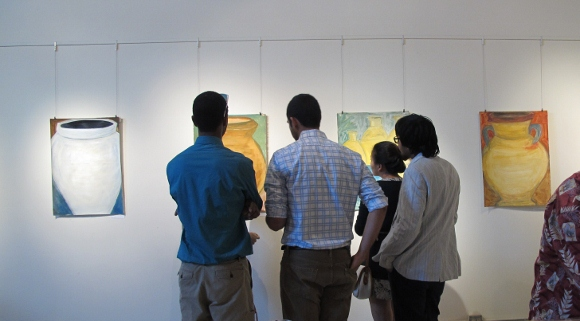 gallery-goers view Nancy Selvin's works in gouache on paper at the Light Room, Berkeley, CA, 11-2013. Photo by BF Newhall