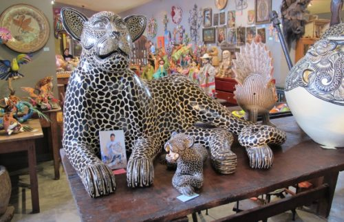 Interior of Galeria Atotonilco, San Miguel de Allende, Mexico, with hand-painted figurines of jaguars. Photo by BF Newhall